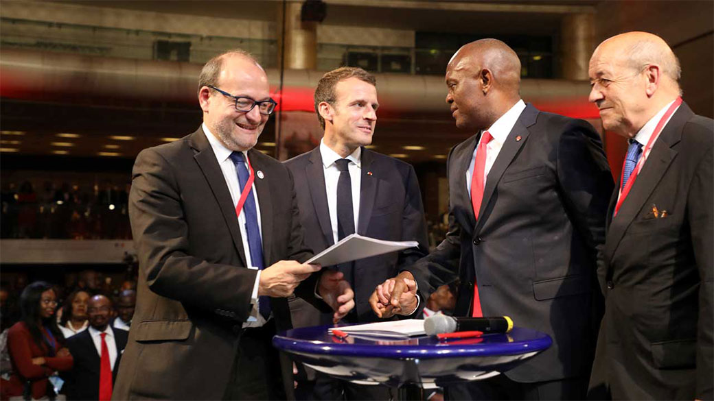 Managing Director Remy Riou, French President Emmanuel Macron, Elumelu Foundation President Tony Elumelu and French Foreign Affairs Minister Jean-Yves Le Drian sign a financial agreement to promote business and entrepreneurs at a meeting in Lagos