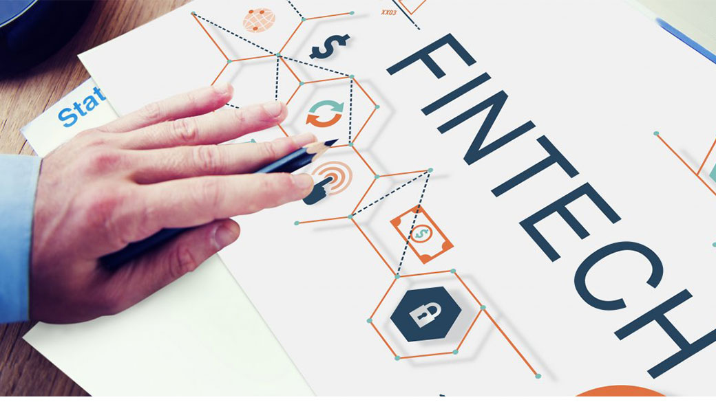 hand and pencil over Fintech logo